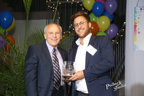 Todd Leebow, CEO and President of Majestic Steel USA receiving the Sam Miller Goodness Award given by Ron Kahn, Founder of Ronald McDonald House of Cleveland.