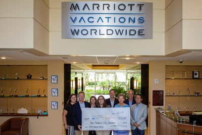 Marriott Vacations Worldwide's Caring Classic team presents check to Orlando Health Arnold Palmer Hospital for Children.