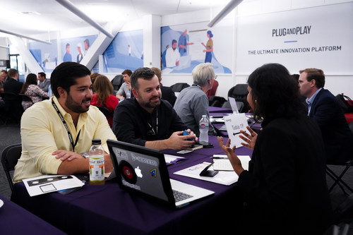 Startups meet with Plug and Play's corporate partners during a speed-networking event.