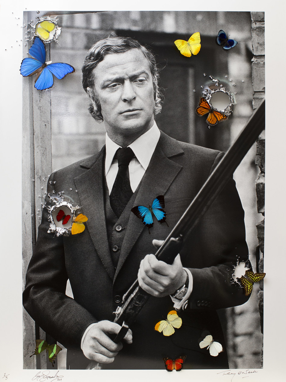 'Hollywood Reloaded Michael Caine' by Bran Symondson, 2019 (76.2 cm x 101.6 cm). A special collaboration between Terry O'Neill and Bran Symondson presented by HOFA Gallery.
