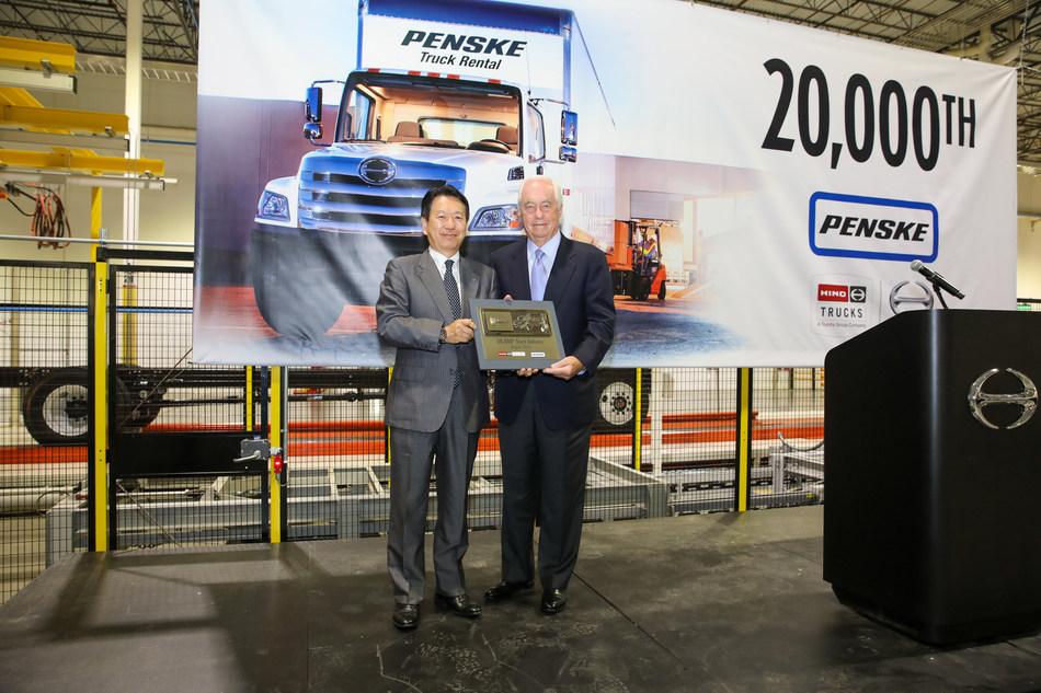Yoshio Shimo President of Hino Motors Limited presents the commemorative 20000th truck key to Roger Penske.