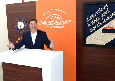 "Clem Bence, brand leader and vice president of operations for Howard Johnson by Wyndham, welcomes guests to ""HoJo's Sweet Escape"" in New York, Thursday, Aug. 22, 2019. Marking the brand's largest design-refresh in more than 25 years, the pop-up event celebrates HoJo's newly redesigned retro-cool guestrooms, which feature modern design with a playful nod to the nostalgic days of orange roofs, ice cream and family road trips. (Diane Bondareff/AP Images for Howard Johnson by Wyndham)"