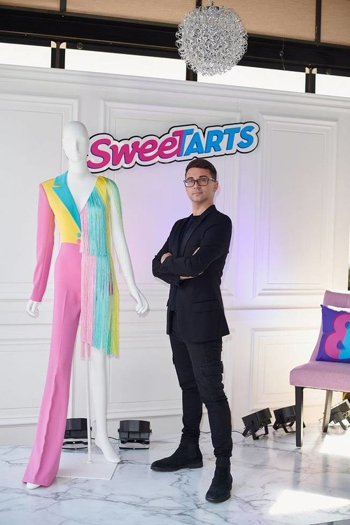 """Fashion designer Christian Siriano celebrates the """"freedom to be more than one thing"""" with a custom-designed SweeTARTS-inspired couture design unveiled on Thursday, August 22nd, 2019, in New York, NY."""