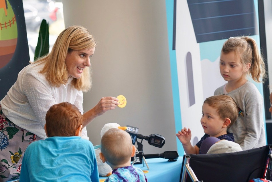 Aflac Senior Manager of Corporate Social Responsibility Buffy Swinehart demonstrates My Special Aflac Duck for children at the Roswell Park Comprehensive Cancer Center in Buffalo, New York on Aug. 23, 2019.