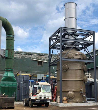 A quench/packed tower scrubber and stack for venting steam sits in the foreground of the new regenerative thermal oxidizer (RTO) at General Iron Industries in Chicago.