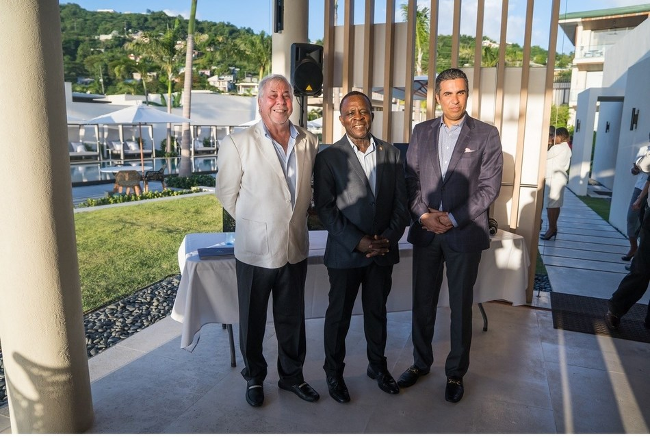 The Honorable Dr Keith Mitchell, Prime Minister of Grenada (C); Kamal Shehada (L) & Mohammed Asaria (R), Joint Managing Directors and Board Members of Range Developments