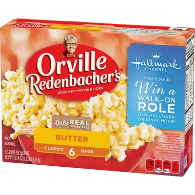 "Orville Redenbacher's Gourmet Popping Corn, Swiss Miss Cocoa, and Hallmark Channel have teamed up for the ""Snack, Watch and Win"" Sweepstakes. One grand prize winner will receive a walk-on role in an upcoming Hallmark Channel original movie, along with a one-year supply of Orville Redenbacher's microwave popcorn."