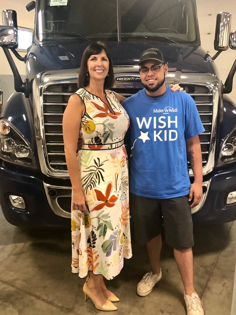 Wish Kid and Cancer Survivor Jaime Gamez and Universal Technical Institute (UTI) President and CEO Kim McWaters after Jaime's wish to train to be a diesel technician is granted in full by Make-A-Wish Arizona, UTI and industry partners.