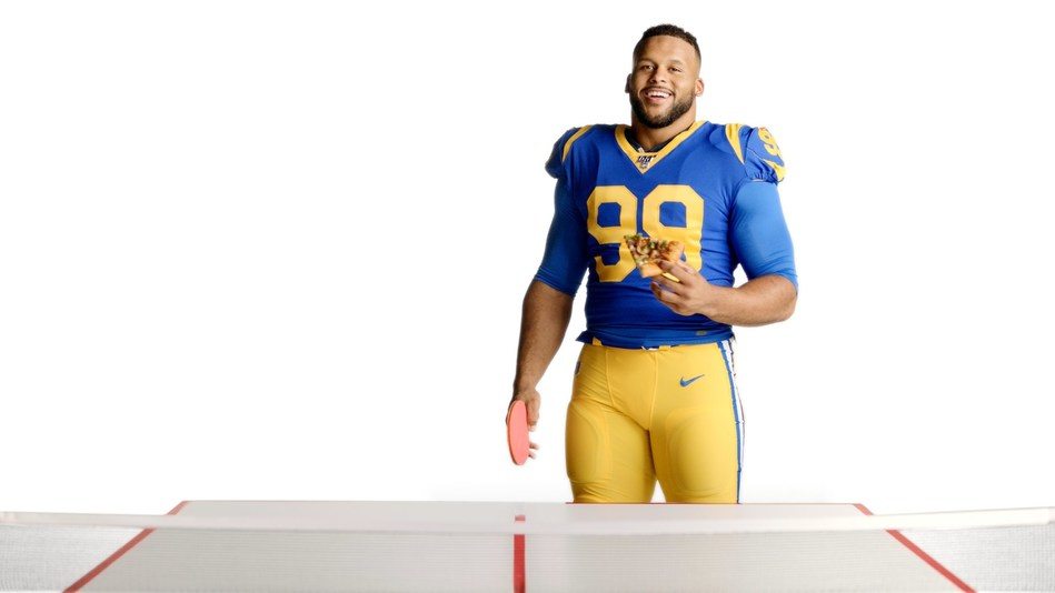 Pizza Hut kicks off its second year as the Official Pizza Sponsor of the NFL by announcing a new player partnership with Los Angeles Rams' Aaron Donald and the launch of Hut Hut Win, an NFL season-long sweepstakes that gives fans the chance to win once-in-a-lifetime NFL experiences – including a chance to take on Donald during a ping pong pizza party!