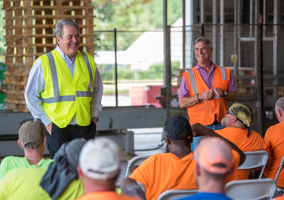 PalletOne CEO Howe Wallace (left) with Bay Wood Products founder Jimmy Wilson (right) announced the acquisition of Bay Wood Products by PalletOne Inc.