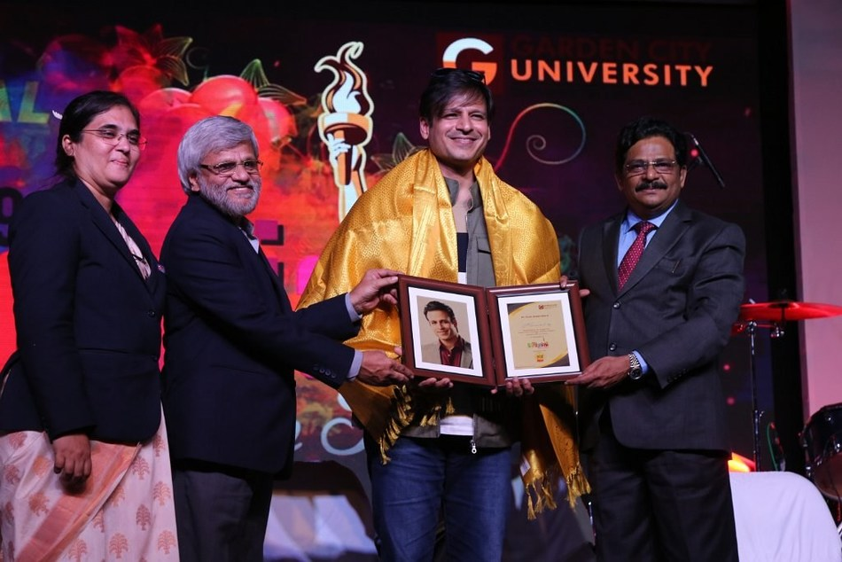 Vivek Oberoi being felicitated by Dr Joseph VG, Chancellor – GCU (standing on the extreme right) in the presence of Registrar and Deputy Registrar of Garden City University