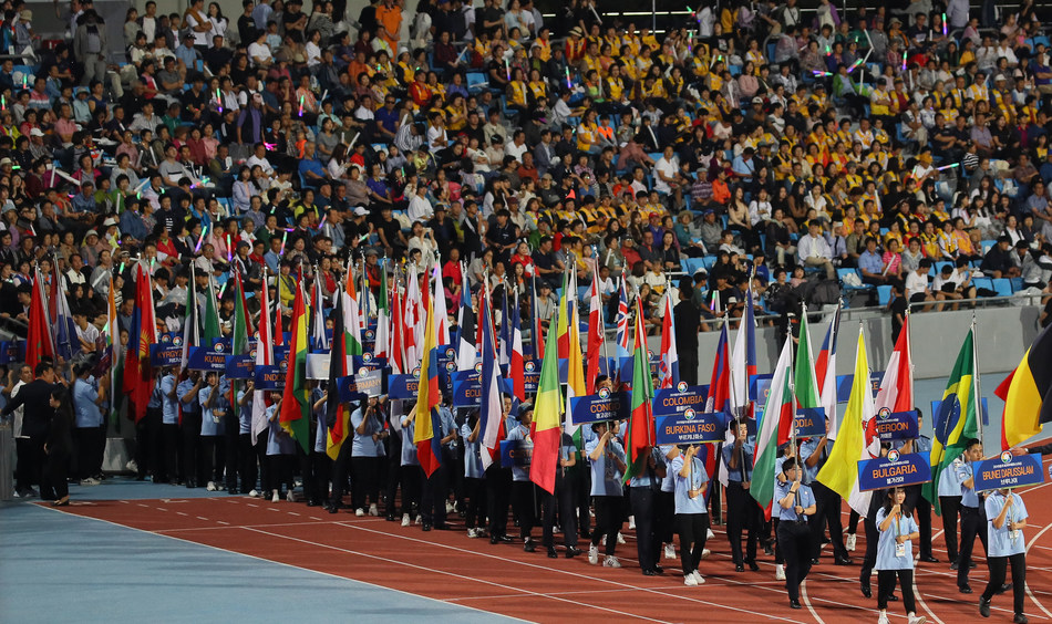 Flag-bearers and athletes march during the opening ceremony of the 2019 Chungju World Martial Arts Masterships at Chungju Stadium in Chungju, about 150 kilometers southeast of Seoul, on Aug. 30, 2019