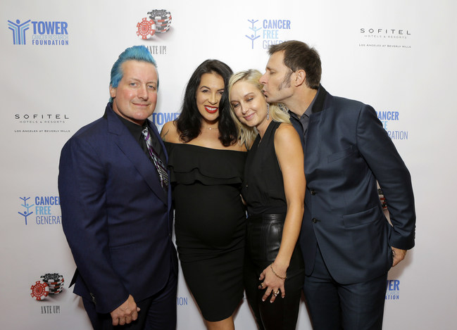 Legendary band Green Day's Mike Dirnt and Tre Cool with their wives Brittney Cade Pritchard & Sara Rose Wright at Tower Cancer Research Foundation's Cancer Free Generation Celebrity Poker Tournament in 2018. Brittney, a breast cancer survivor and her husband, Mike were honored at the 2018 Tower CFG Poker Tournament for their courageous example as a couple sharing their personal cancer journey in order to help others.
