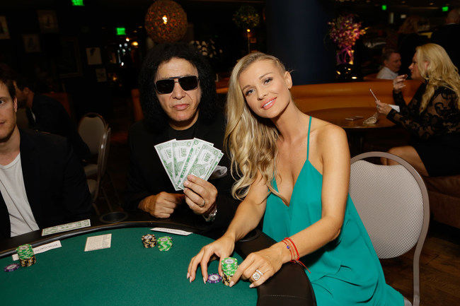 Gene Simmons & Joanna Krupa at Tower Cancer Research Foundation's Cancer Free Generation Celebrity Poker Tournament in 2016.
