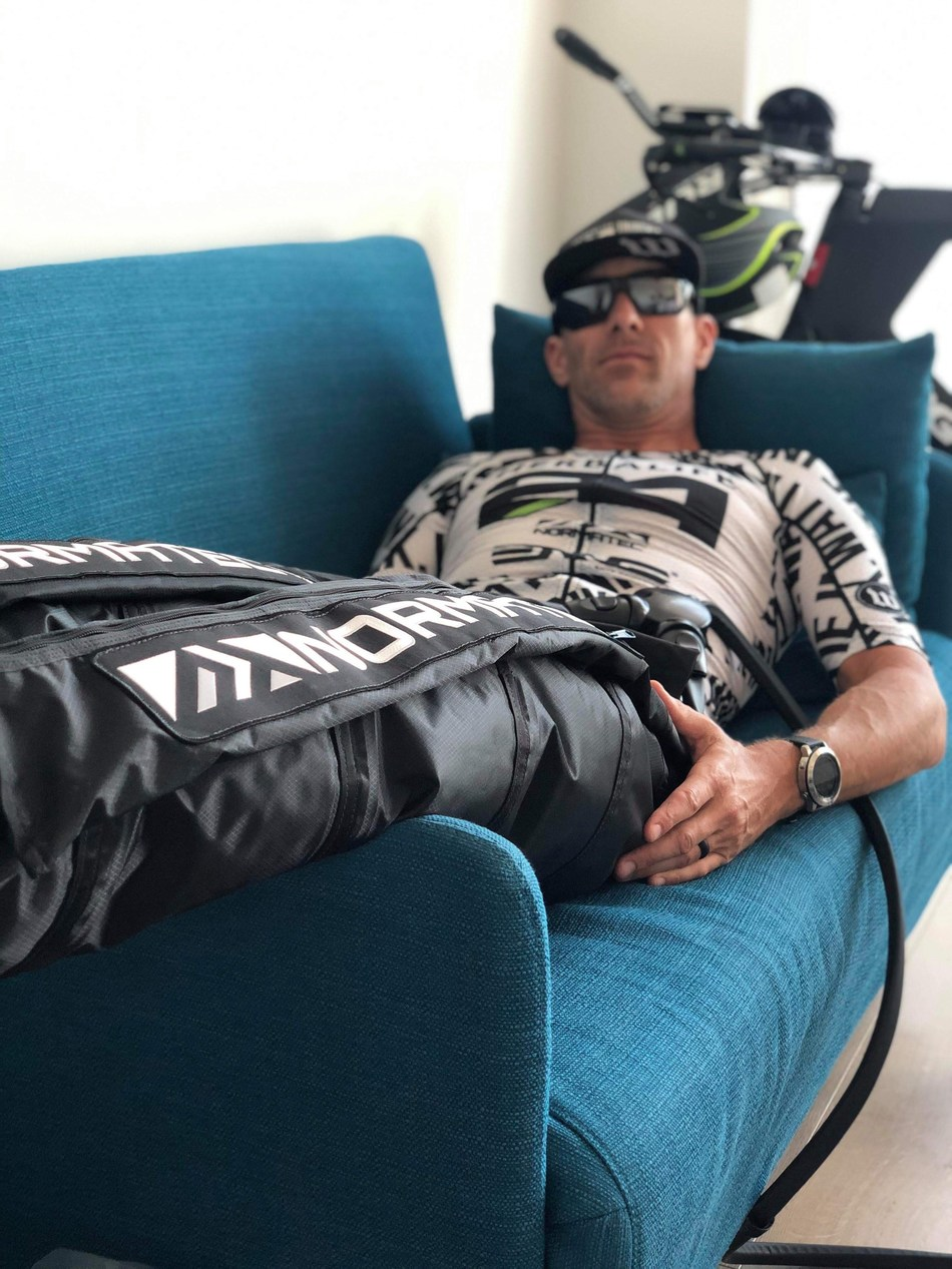 Wattie Ink. athlete Marc Nester recovering with NormaTec. Photo by Doris Nester.