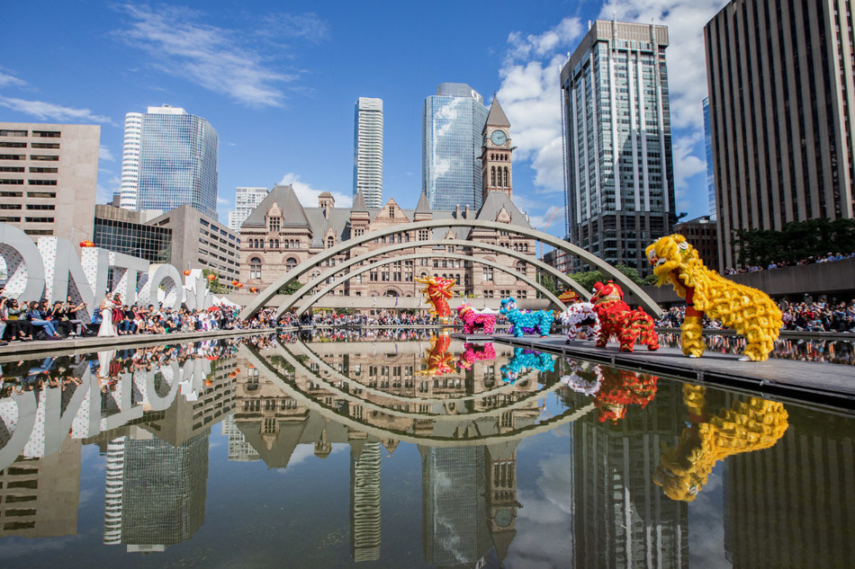 2019 Toronto Dragon Festival presents the creative shows on water with dragons, lions, fashions, Kong Fu, and Tai Chi. (CNW Group/Canadian Association of Chinese Performing Arts)