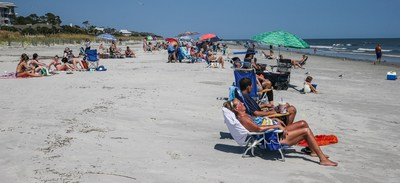 Visitors and locals return to the resorts and beaches of Hilton Head Island, S.C. after the Island received the 'all clear' from officials following Hurricane Dorian Friday, Sept. 6, 2019. (Gary McCullough/AP Images for Hilton Head)