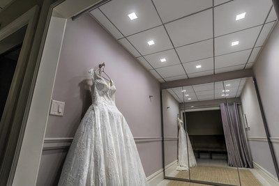 "To address any inkling of ""cold feet,"" Kleinfeld Bridal of NYC chose Amerlux's square Hornet HP Dim-To-Warm Downlights for its 19 fitting rooms. The 185 downlights are equipped with Class A LED chips for exquisite color rendering and lensed optics. Amerlux's Hornet downlights with Class A LED chips brings out the brilliant true colors in Kleinfeld's bridal dresses in ways that the old lighting could not produce."