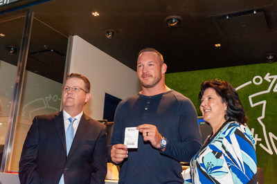 Chicago Hall of Fame linebacker Brian Urlacher shows the first bet placed at the FanDuel Sportsbook at Blue Chip Casino, Thursday, September 5, 2019. L to R: Bill Wright, Boyd Gaming Sr. Vice President, Operations; Brian Urlacher; and Blue Chip Vice President and General Manager Brenda Temple.