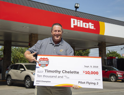 Timothy Chelette, winner of Pilot Flying J's 2019 Road Warrior contest honoring professional drivers, presents $10,000 prize at the Pilot Travel Center in his hometown of Murfreesboro, Tenn.