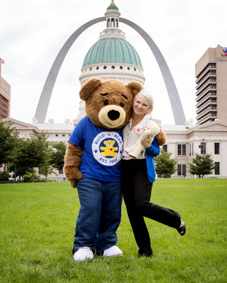 Build-A-Bear's huggable mascot, Bearemy, celebrating National Teddy Bear Day in St. Louis, MO with President & CEO, Sharon Price John.