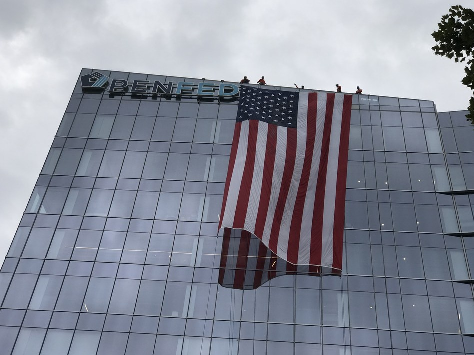 A large American flag drapes over PenFed's corporate headquarters in Tysons, Virginia in honor of American heroes during the terrorist attacks of September 11, 2001.