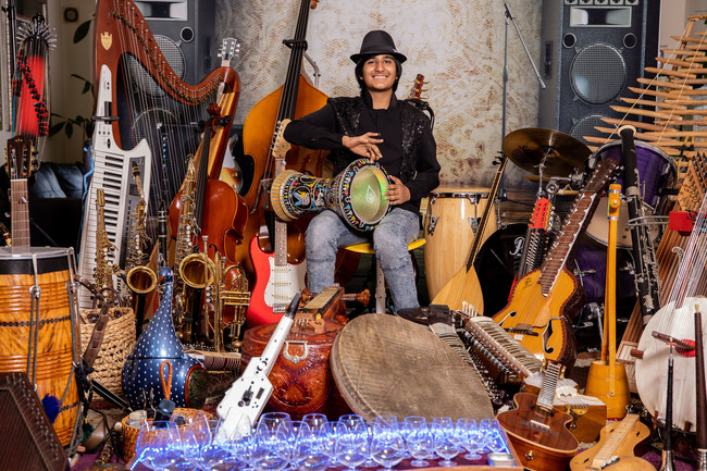 Neil Nayyar in his element surrounded by some of the 107 instruments he has learned to play.