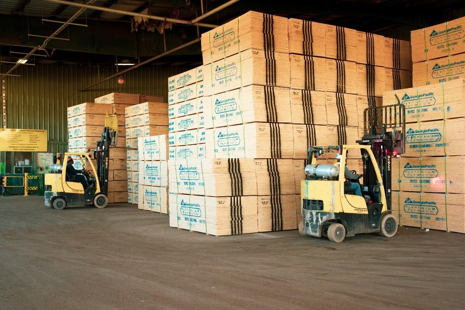 Forklift operators at Georgia-Pacific's Gurdon, Ark., plywood operation lift strap-wrapped 90-sheet bundles of finished plywood sheathing for transport to building and lumber stores across the country.  GP today announced a two-year $70 million upgrade to the plant in southern Arkansas, bringing to $100+ million its investment in plywood and lumber operations there in the past five years.
