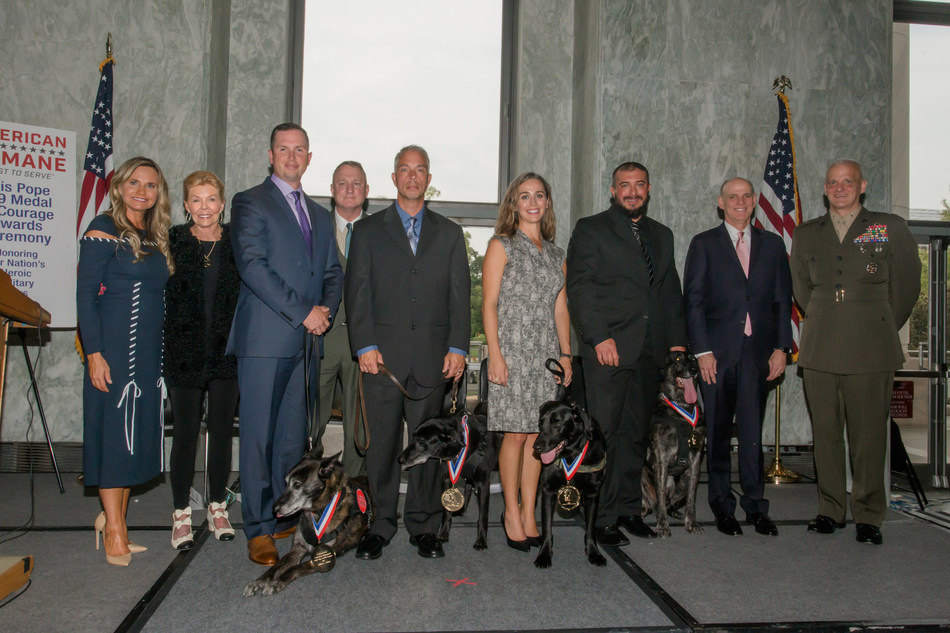 Honoring our warriors' best friends (left to right): American Humane President & CEO Dr. Robin Ganzert, philanthropist Lois Pope, USAF TSgt Robert Wilson and MWD Troll, USMC Colonel Scott Campbell (Ret.), Patrolman Eric Harris and MWD Emmie, Caroline Zuendel and Sgt. Yeager, Luchian Burke and K-9 Niko, Crown Media Family Networks President and CEO Bill Abbott, and USMC Brigadier General Robert C. Fulford. Photo credit: Beth Caldwell for American Humane