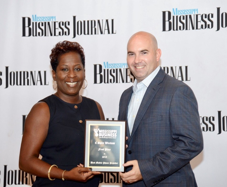 The mobile communications unit of C Spire, a diversified telecommunications and technology services company, has been selected as the best in Mississippi by readers of the Mississippi Business Journal, the state's largest business publication.  Above, Associate Publisher Tami Jones (left) presents reader's choice top award to Jason Thomas, senior manager of wireless sales operations for C Spire, at a Thursday morning awards program.