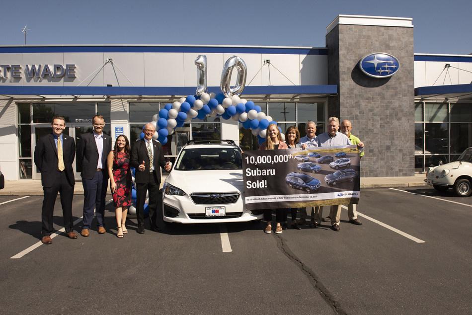 Subaru sells 10-millionth vehicle in the U.S. (L to R) Andrew Sidel (SOA), David Airington (SOA), Jessica Tiedeken (SOA), Barry Jellick (SOA), Rachel Harmon (customer), Marianne Harmon (customer), Kirk Schneider (owner, Nate Wade Subaru), Dr. Craig Harmon (new Impreza owner), Rob Berman (sales manager)