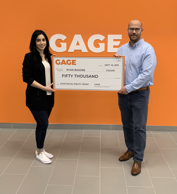 Ryan Basore is presented a social equity grant by Rosie Riashy, Marketing and Community Manager, Gage Cannabis Co.