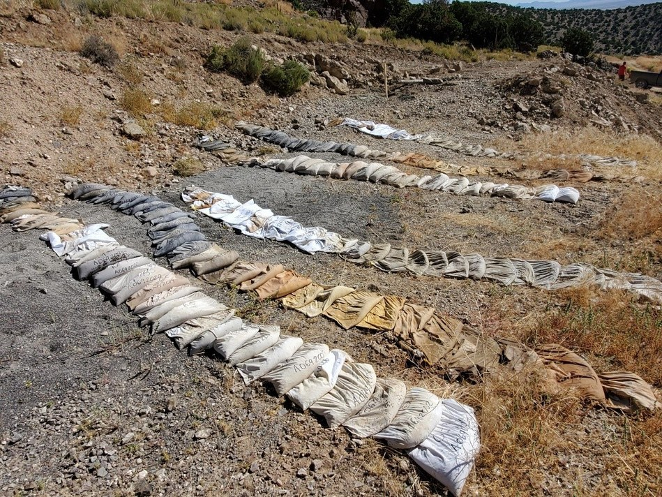 Image #1: Drill-hole #1 cloth sample bags, drying prior to shipment to the lab. Distinctive iron-oxide minerals diagnostic of mineralized zones are evident in multiple bags. (CNW Group/Barrian Mining Corp.)