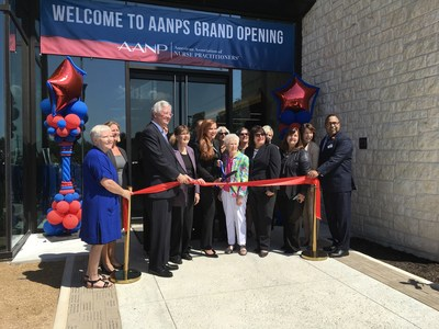 AANP's leadership team, including president Sophia L. Thomas, CEO David Hebert, and past president Joyce Knestrick pose for a picture with Loretta Ford (center) and others before cutting the inaugural ribbon at the grand opening event on Friday.
