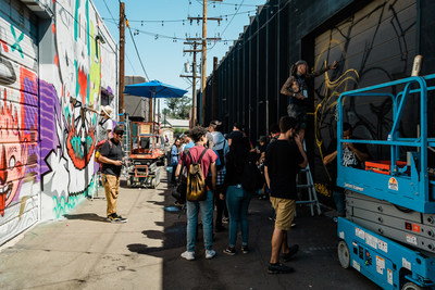 Spectators interact with artists as they create new works of public art during Denver, Colorado's CRUSH WALLS, an international urban art festival. (Credit: Nikki A Rae Photography)