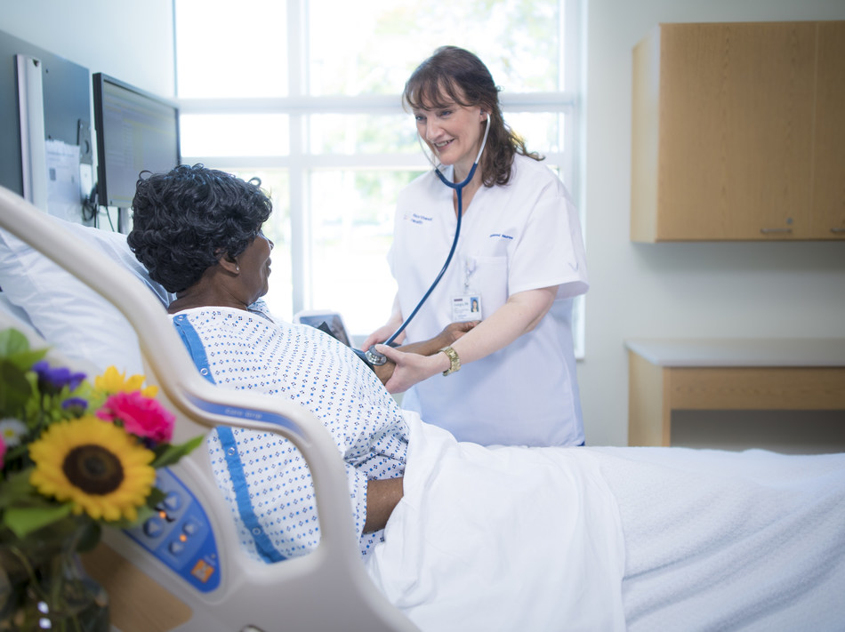 A Northwell Health nurse checks the blood pressure of a patient. Photo credit Northwell Health.