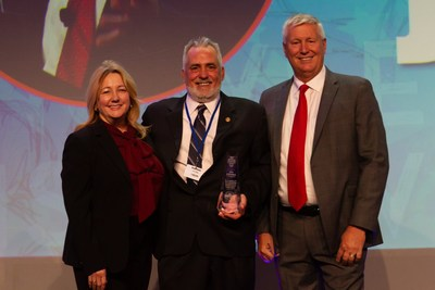 Jim Ullmann, National Air Traffic Controllers Association's director of safety and technology, receives the 2019 Air Traffic Controller of the Year award, presented by Rachel Jackson, Raytheon executive technical director, and Jack McAuley, Raytheon air traffic systems director.
