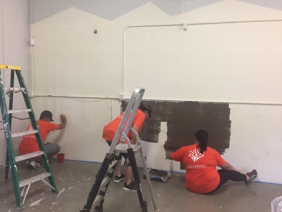 'Ohana Health Plan volunteers paint a teen room at the Boys & Girls Club.