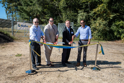 Cutting the ribbon on the Burrillville Solar garden are Greg Lucini, CEO of ISM Solar, Nick Ucci, Deputy Commissioner of RI OER, Jim Rice, Co-CEO of Nautilus Solar, and Kiran Bhatraju, CEO of Arcadia Power.