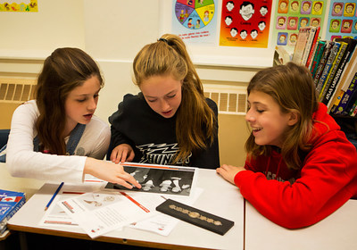 Students at Bayside Middle School in Saint John, New Brunswick, examine an object from the Canadian War Museum's Second World War Discovery Box. (CNW Group/Canadian War Museum)