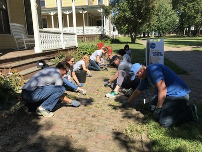 Employee volunteers working to restore historic buildings on Governors Island, in partnership with New York Cares.