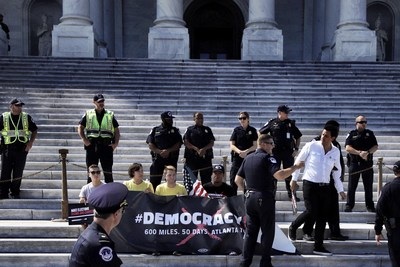 Presidential candidate Ben Gleib being arrested by police during protest at U.S. Capitol demanding an end to government corruption. Photo by Jiffy Lesica