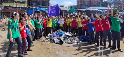 Ryan International School, Malad ICSE students after cleaning the beach