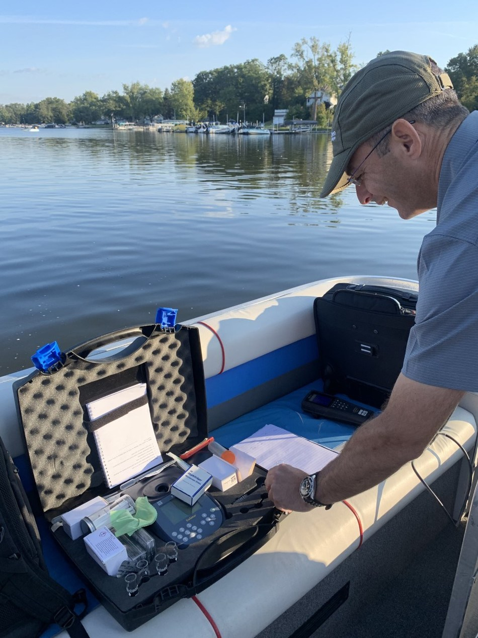 Dr. Moshe Harel, BlueGreen Water Technologies CTO, testing cyanobacteria-free water at Chippewa Lake this week, result of successful treatment conducted weeks ago