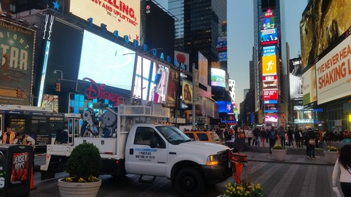 Stealth Communications' fiber crew installing fiber-optic cables in NYC's Times Square neighborhood.
